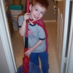 A superhero helps with the mopping